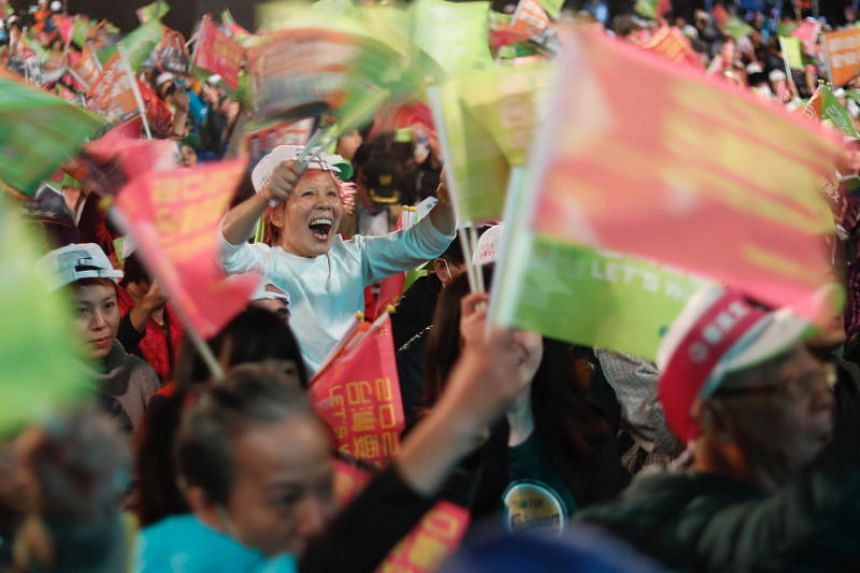 Supporters of Taiwan President Tsai Ing-wen cheer during an election campaign event in New Taipei City, on Jan 5, 2020.