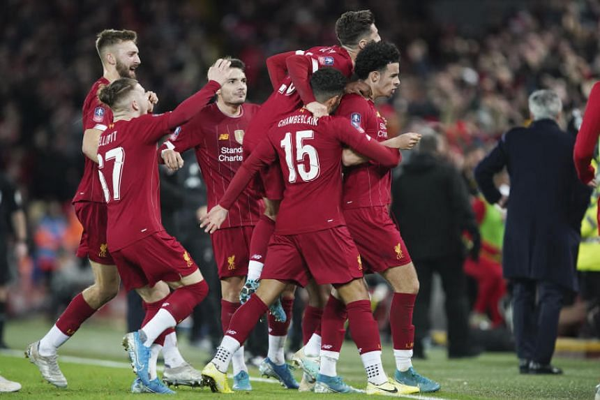 Liverpool's Curtis Jones (right) celebrates with his teammates after scoring his side's opening goal during the English FA Cup third round match against Everton at Anfield on Jan 5, 2020.