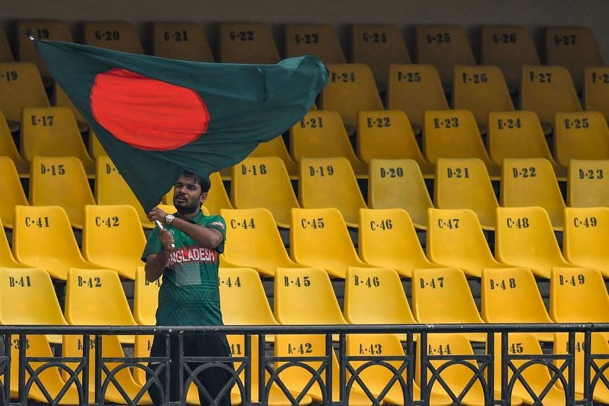 A Bangladesh cricket fan waves the country's national flag at the Holkar Cricket Stadium in Indore on Nov 13, 2019.