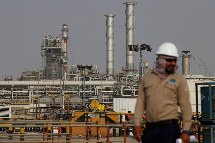 In a photo taken on Oct 12, 2019, an employee looks on at Saudi Aramco oil facility in Abqaiq, Saudi Arabia.