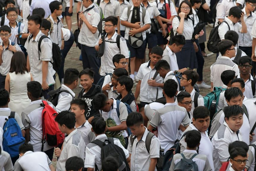 Boon Lay Secondary School students leaving the school's parade square after assembly.