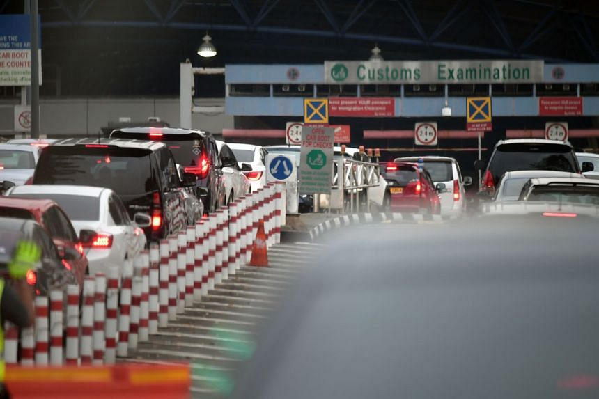 Vehicles heading towards the Woodlands customs checkpoint in the evening peak hour traffic on Oct 31, 2019.