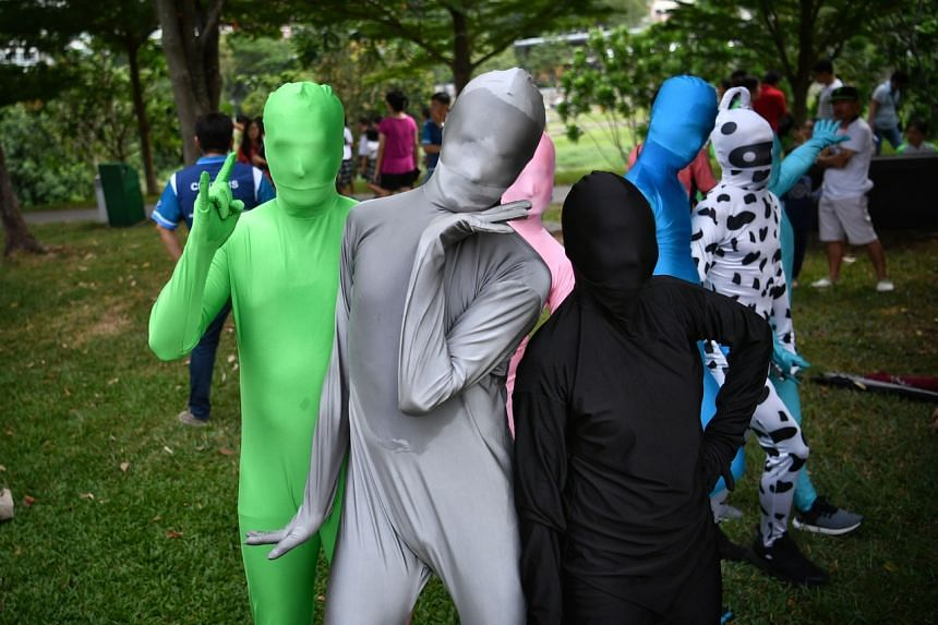 In a photo taken on July 7, 2019, Zentai performers strike a pose at the PAssionArts Festival. Official figures last year show the number of performing arts events rose from around 7,700 in 2011 to more than 9,500 in 2017.