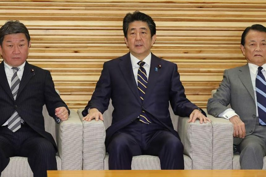 Japan's Prime Minister Shinzo Abe (middle) with members of his cabinet in Tokyo on Dec 27, 2019.