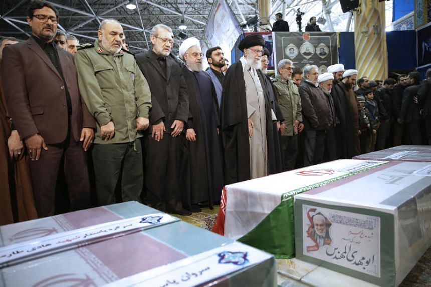 Iran's supreme leader Ayatollah Ali Khamenei (centre) leads a prayer over the coffins of Qassem Soleimani and his comrades at the Teheran University campus, in Teheran on Jan 6, 2020.