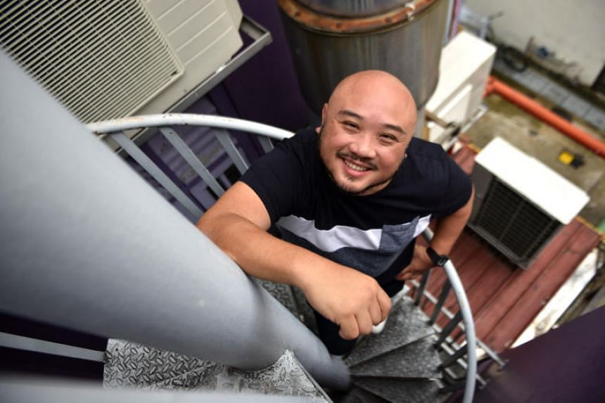 Artistic Director of Toy Factory Productions Ltd, Goh Boon Teck, poses by his office's spiral staircase. Toy Factory Productions celebrates its 30th anniversary this year and has a series of productions planned.