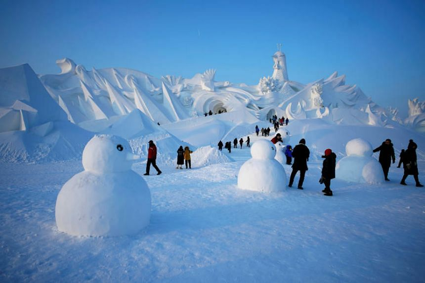 People at the Harbin International Ice and Snow Sculpture Festival in China on Jan 5, 2020.