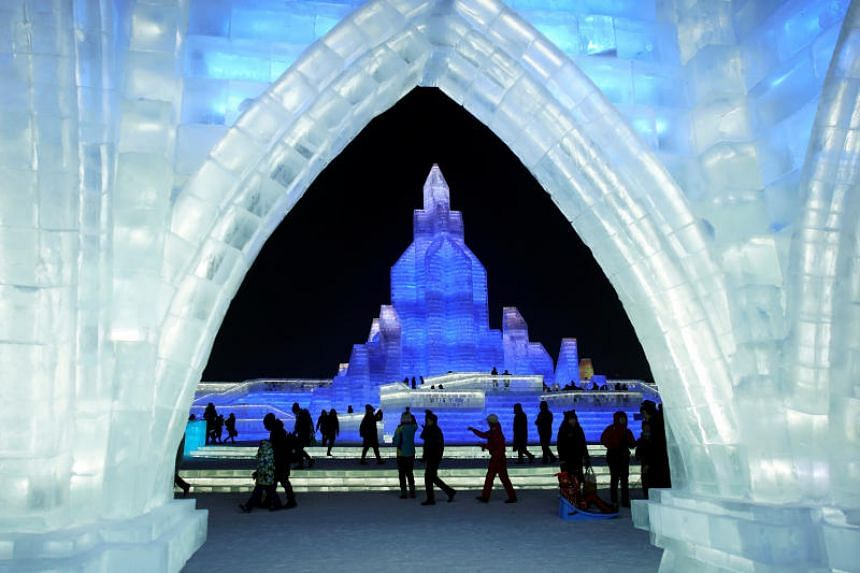 People at the opening day of the Harbin International Ice and Snow Sculpture Festival in China on Jan 5, 2020.