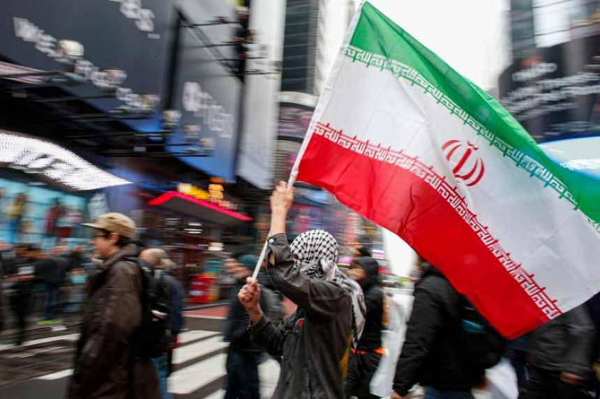 A man holds a Iranian flag during an protest in New York on Jan 4, 2020.