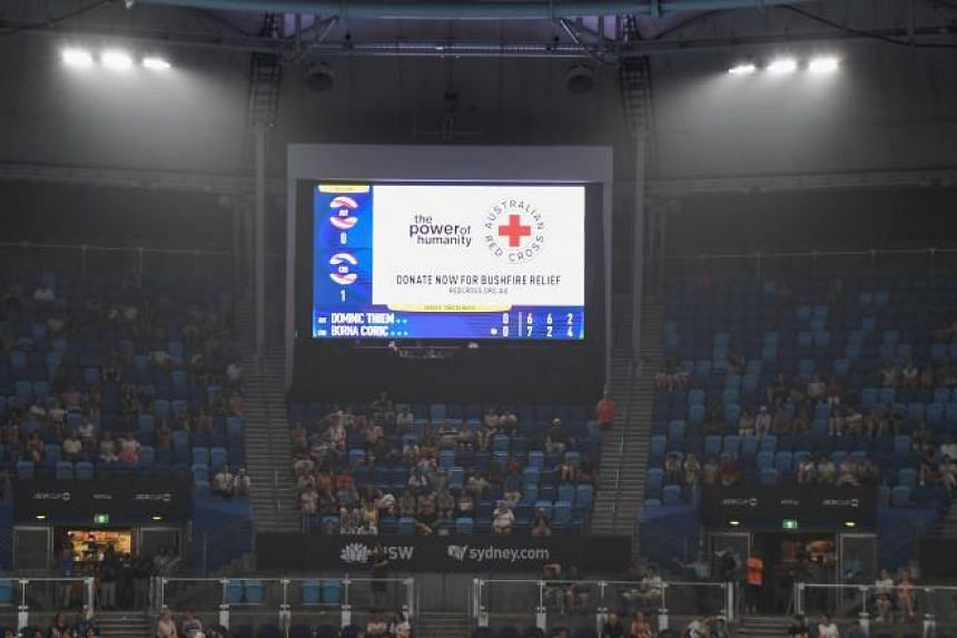 A photo taken on Jan 4, 2020 shows a message asking for donations for the Australian Red Cross bush fires relief during the ATP Cup men's singles match between Dominic Thiem and Borna Coric in Sydney.