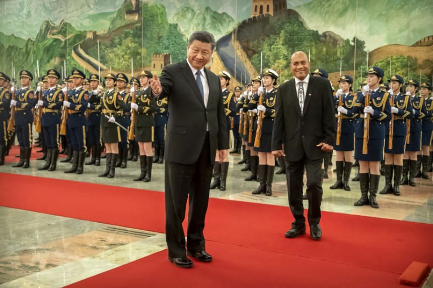 Chinese President Xi Jinping (left) and Kiribati's President Taneti Maamau during a welcome ceremony at the Great Hall of the People in Beijing on Jan 6, 2020.