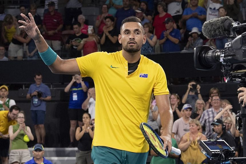 Kyrgios celebrates after winning his singles match against Stefanos Tsitsipas.