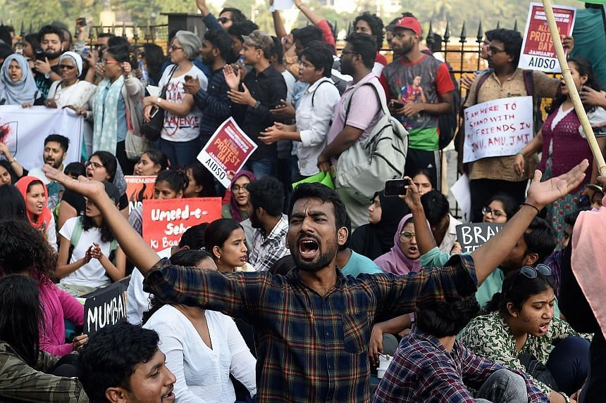Students protesting in Mumbai yesterday against the violent clashes at the Jawaharlal Nehru University on Sunday.