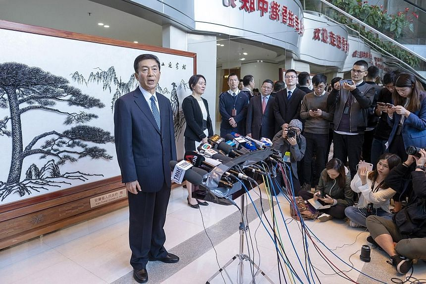Mr Luo Huining, director of the central government's liaison office in Hong Kong, at a press conference in the city yesterday. Unlike his predecessors, Mr Luo is the first liaison office director to have never held a Hong Kong-related position.