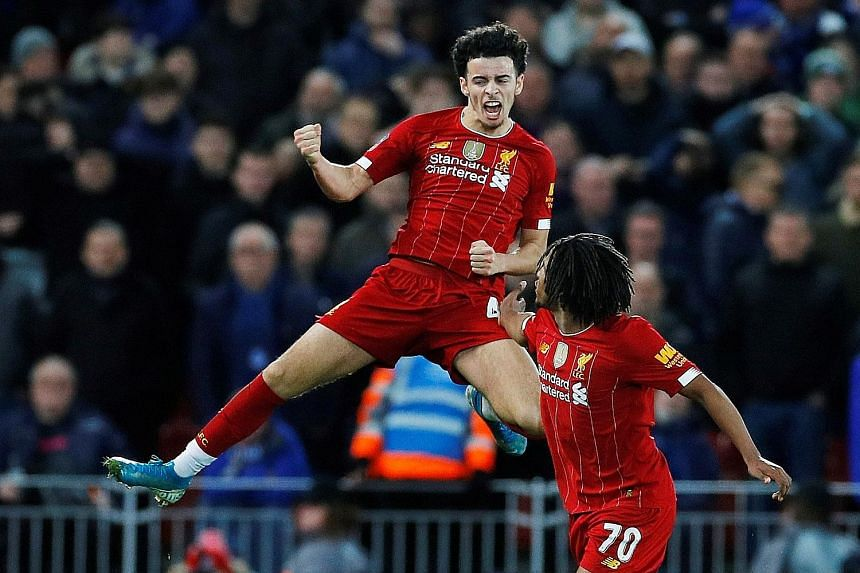 Liverpool's Curtis Jones celebrating his goal with teammate Yasser Larouci. Everton's 1-0 defeat in the FA Cup third round means they have not won for 23 games at Anfield in all competitions.