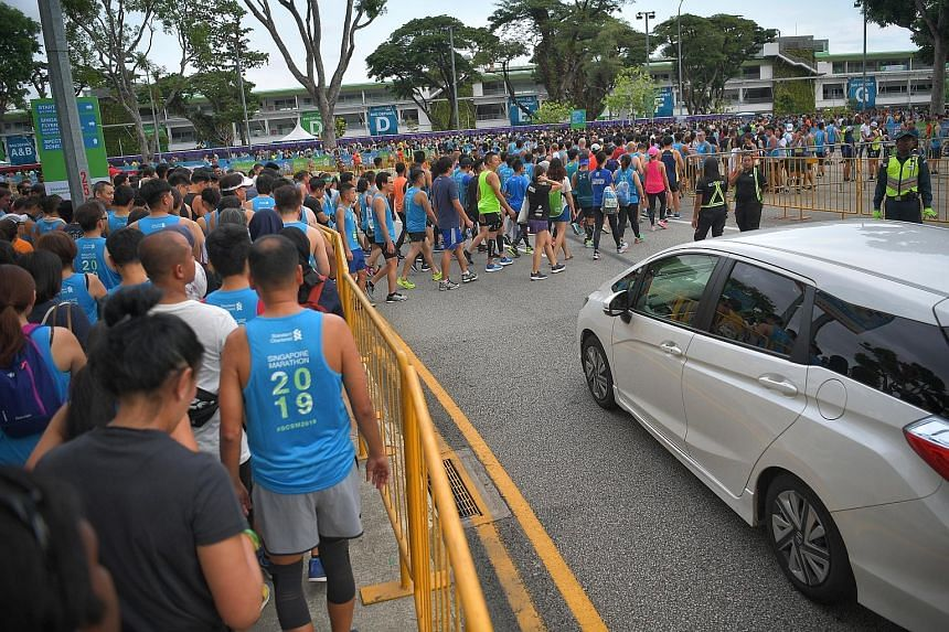 A crowd making its way to the F1 Pit Building - the start line of the 2019 Standard Chartered Singapore Marathon. The marathon and half-marathon events attracted almost 30,000 participants.