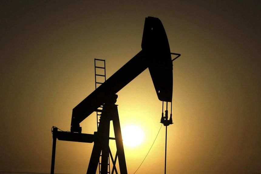 Sun sets behind an oil pump in the desert oil fields of Sakhir, Bahrain on June 8, 2011. Brent crude fell as much as 1.5 per cent to US$67.86 a barrel and was at US$68.14.