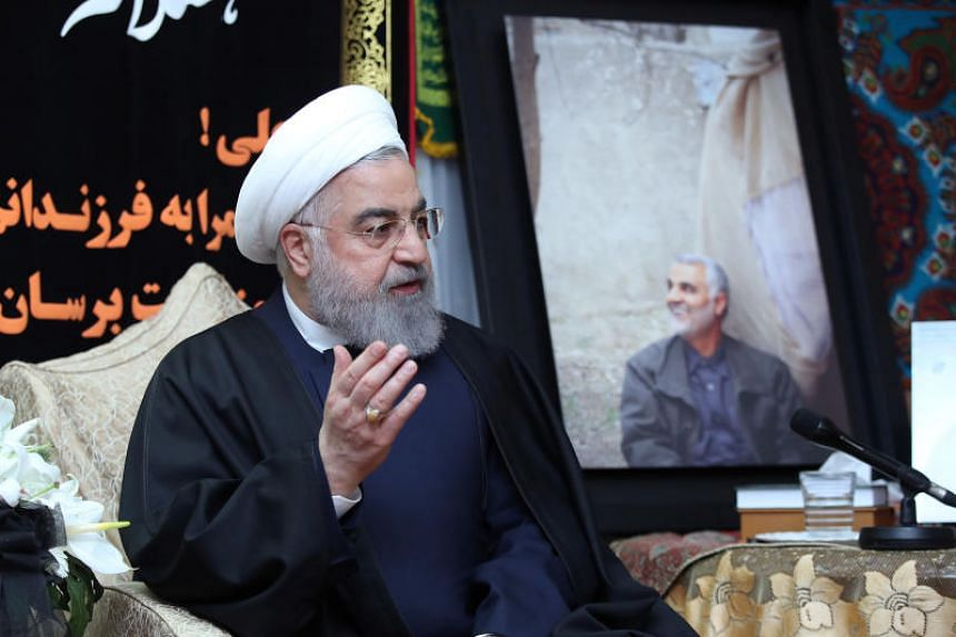 Iranian President Hassan Rouhani visits the family of the top commander Qassem Soleimani, who was killed by an air strike in Baghdad, at his home in Teheran, on Jan 4, 2020.