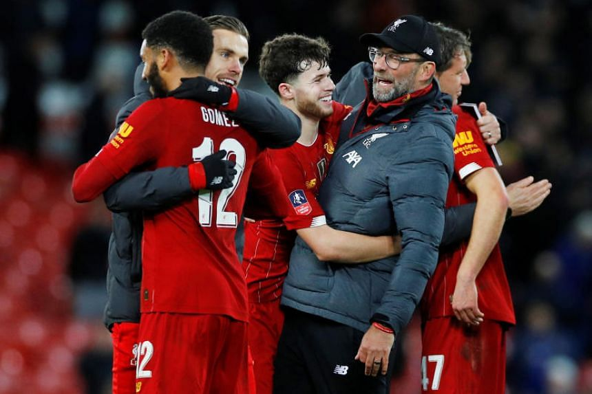 Liverpool players celebrate with manager Jurgen Klopp after the FA Cup football match against Everton on Jan 5, 2020.