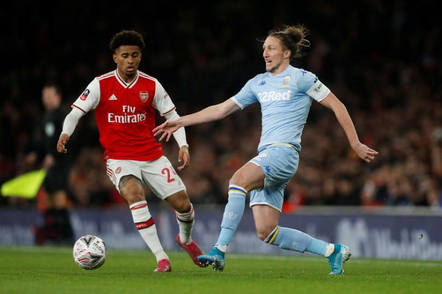 Arsenal's Reiss Nelson (left) in action with Leeds United's Luke Ayling during their FA Cup football match in London, on Jan 6, 2020.