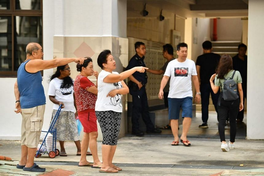 Residents and police officers at Block 534 Bedok North Street 3, on Jan 7, 2020.