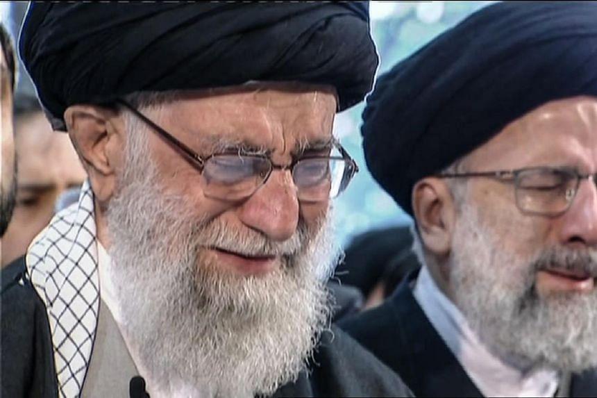 Iranian Supreme Leader Ayatollah Ali Khamenei (left) weeping as he recites a prayer in front of the coffin of slain Iranian military commander Qasem Soleimani in Teheran on Jan 6, 2020.
