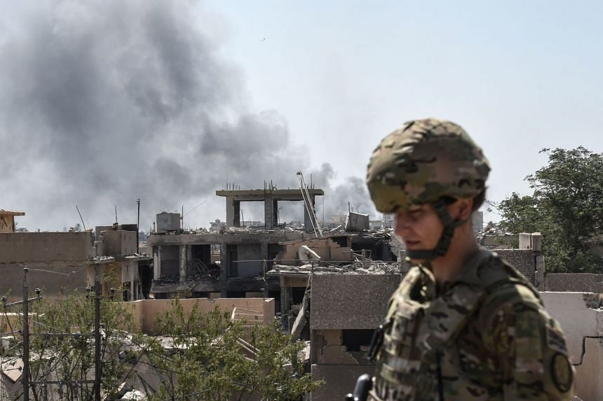 A photo taken on June 21, 2017, showing a US soldier in the city of Mosul in Iraq.