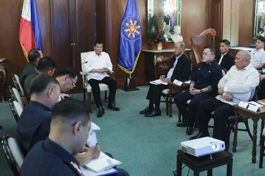 Philippine President Rodrigo Duterte (centre) speaks with security officials at the Malacanang presidential palace in Manila, Philippines, on Jan 5, 2020.