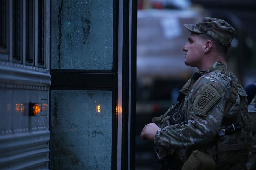 A soldier boarding a bus in preparation for deployment to the Middle East, at Fort Bragg in Fayetteville, US, on Jan 4, 2020.