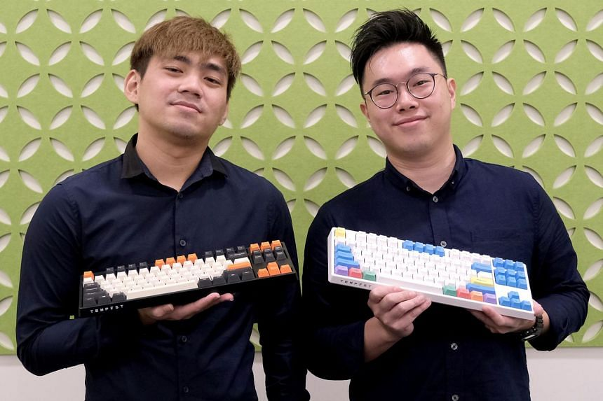 Local tech start-up Tempest co-founders Mr Eric Heng (left) and Mr Ben Hui with the Kirin keyboards they made.
