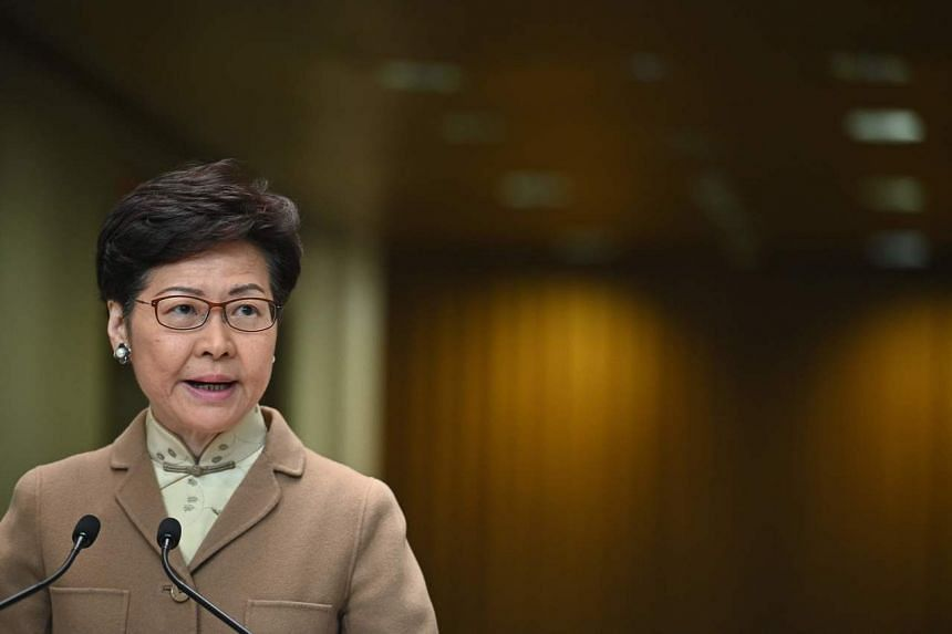 """Hong Kong leader Carrie Lam said on Jan 7 that she was sure she could work with new Liaison Office director Luo Huining in accordance with the """"one country, two systems"""" framework and the Basic Law to ensure the continued stability of the city."""