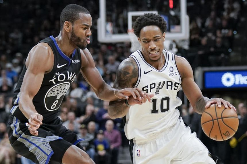 DeMar DeRozan (right) scored 25 points to help the San Antonio Spurs to a 126-104 upset of the NBA-leading Milwaukee Bucks.