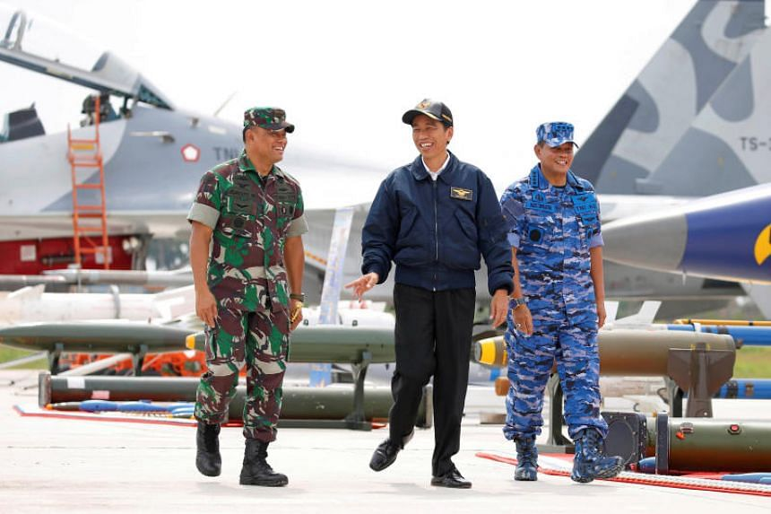 A photo taken on Oct 6, 2016, shows Indonesia's President Joko Widodo with Military Chief Gatot Nurmantyo (left) and Air Force Commander Agus Supriatna during a military exercise on Natuna Island.