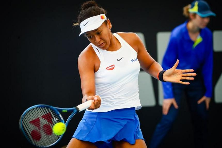 Naomi Osaka hits a return against Maria Sakkari during their women's singles match on day two of the Brisbane International tennis tournament on Jan 7, 2020.