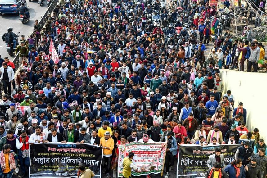 Protesters march as they take part in a demonstration against India's new citizenship law in Guwahati on Jan 5, 2020.