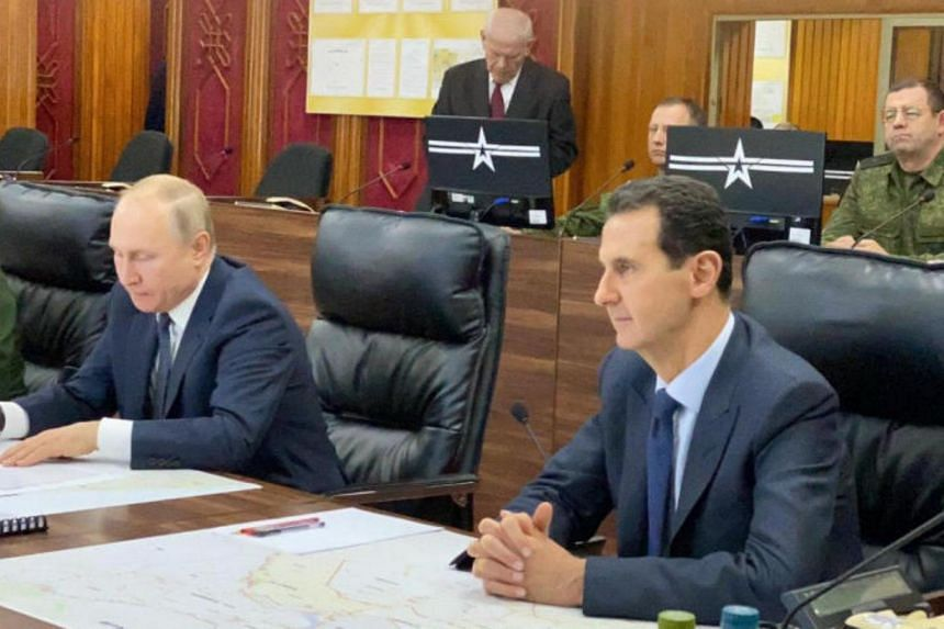 In this handout picture, Russian President Vladimir Putin and Syrian President Bashar al-Assad are seen during a meeting in Damascus on Jan 7, 2020.
