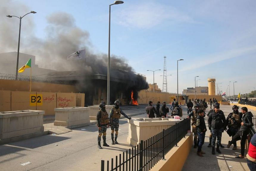 Iraqi security forces gather at the entrance of the US embassy in the Iraqi capital Baghdad on Jan 1, following a demonstration.