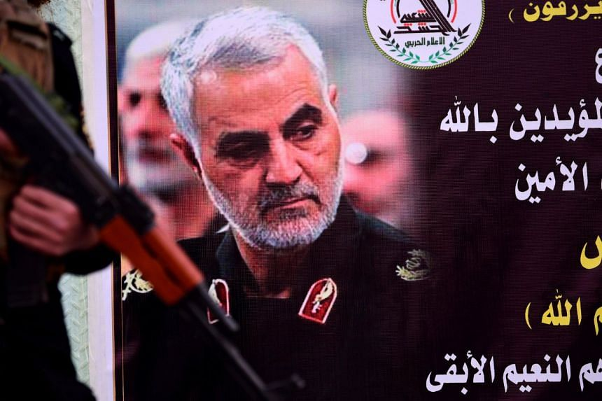 Soleimani is shown on an obituary notice in front of a military base in Baghdad, Iraq.