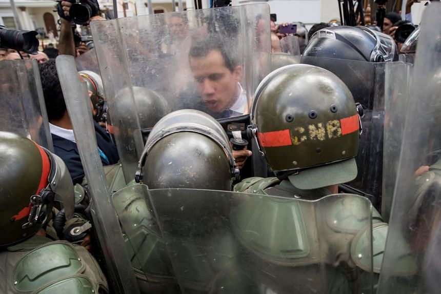 Guaido and several dozen deputies face members of the Bolivarian National Guard in Caracas.