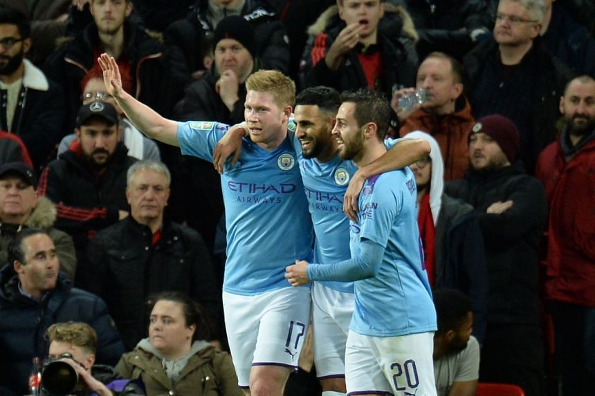 City's Riyad Mahrez (centre) celebrates his goal with team mates.