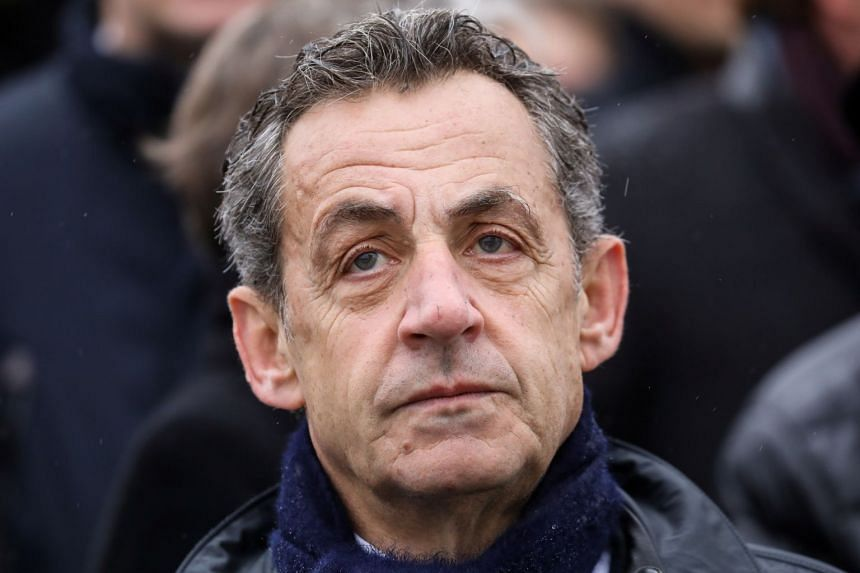Sarkozy attending a World War I remembrance ceremony at the Arc de Triomphe in Paris, Nov 11, 2019.