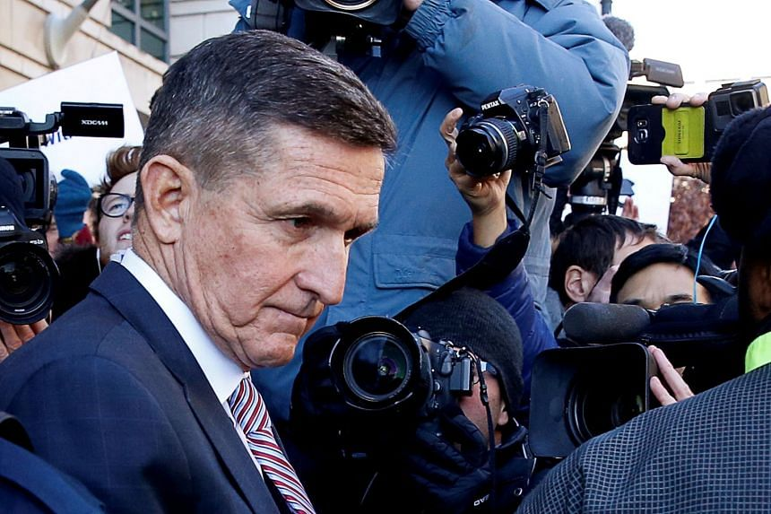 A 2018 photo shows Flynn leaving a Washington court after his sentencing was delayed.