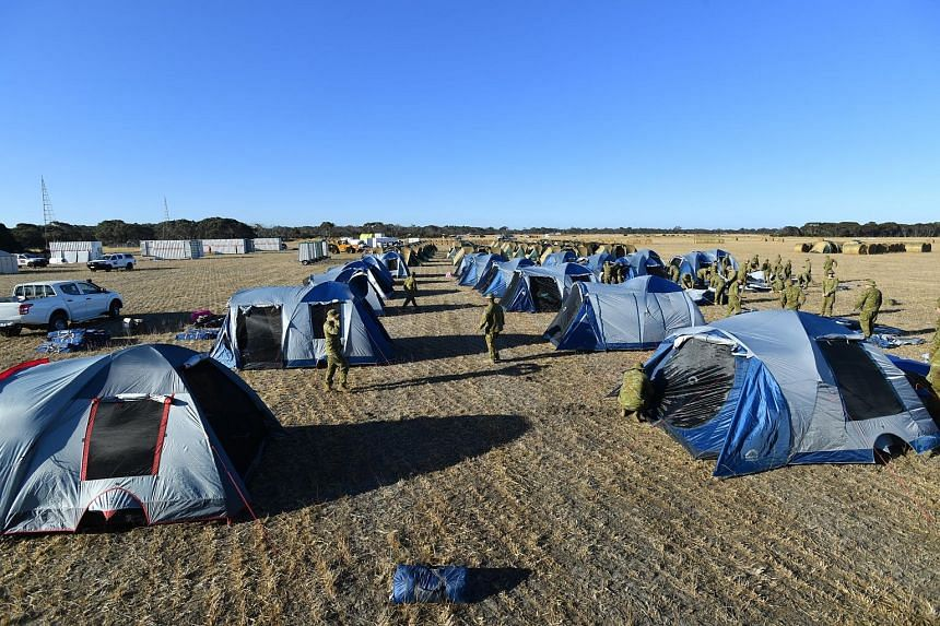 Soldiers setting up camp at Kingscote Airport in Australia's Kangaroo Island on Monday after they were deployed there to help with bush-fire relief.