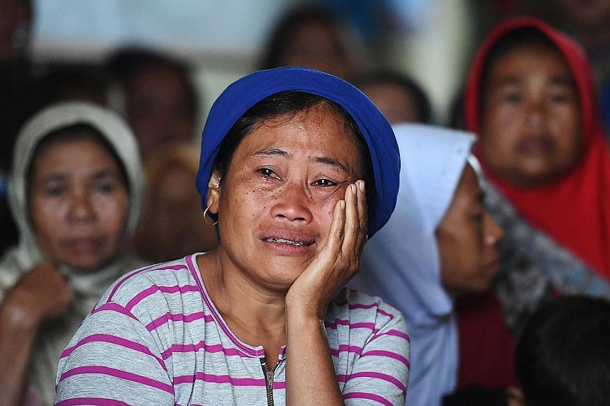 A woman affected by a landslide, at a temporary shelter in Bogor, West Java province, Indonesia, on Sunday.
