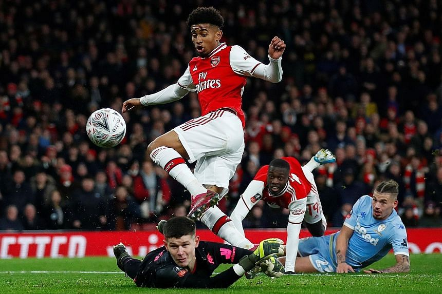 Reiss Nelson scoring during the 1-0 FA Cup third-round win over Leeds on Monday. Arsenal, who will face Bournemouth next, improved after a difficult first half. PHOTO: REUTERS