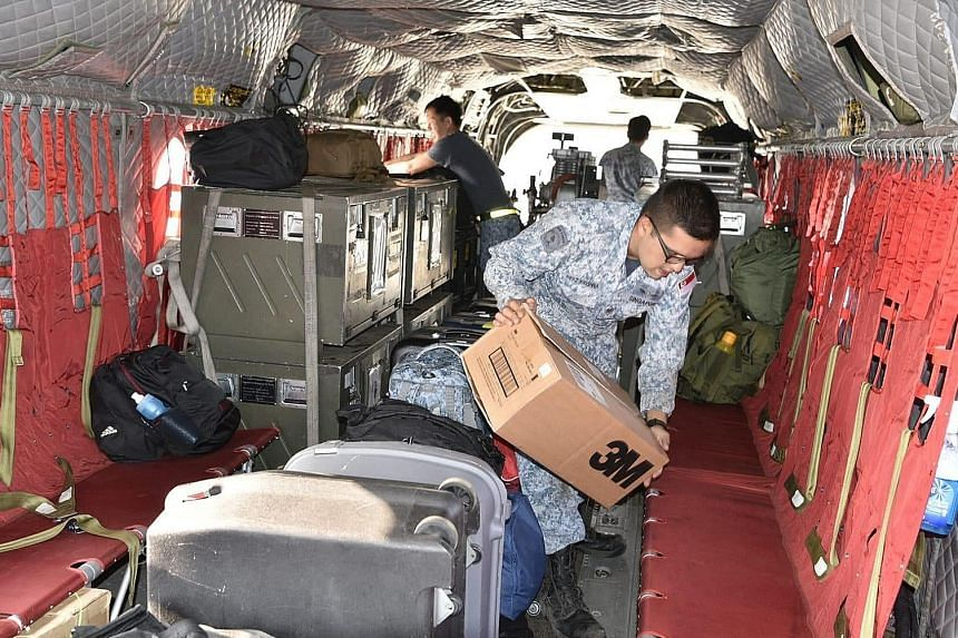RSAF personnel loading firefighting and relief supplies onto a Chinook bound for Royal Australian Air Force Base East Sale in Victoria state. Singapore's Defence Minister Ng Eng Hen said Australia's bush fires have already destroyed more than 6 milli