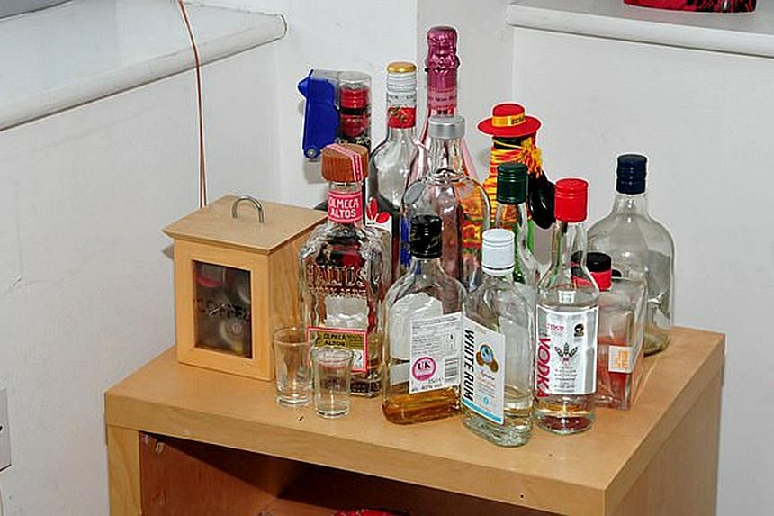 """Reynhard Sinaga's apartment in Manchester, Britain, where the sexual assaults took place. Bottles of spirits (below) were found in the flat. Many of his victims recalled he gave them a drink - which he once described to a WhatsApp group as """"secret po"""