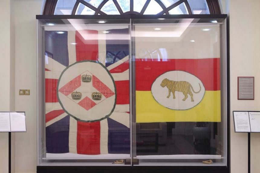 The Union flag (left) and the flag of the Federated Malay States at the Ministry of Foreign Affairs in an area that once housed Tanglin Barracks.