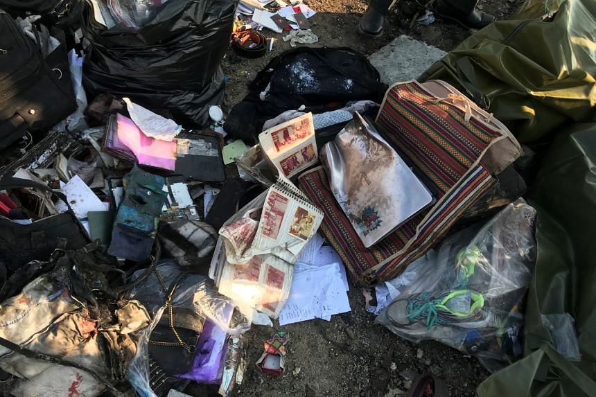 Passengers' belongings are seen after the Ukraine International Airlines plane crashed after take-off from Iran's Imam Khomeini airport in Teheran on Jan 8, 2020.