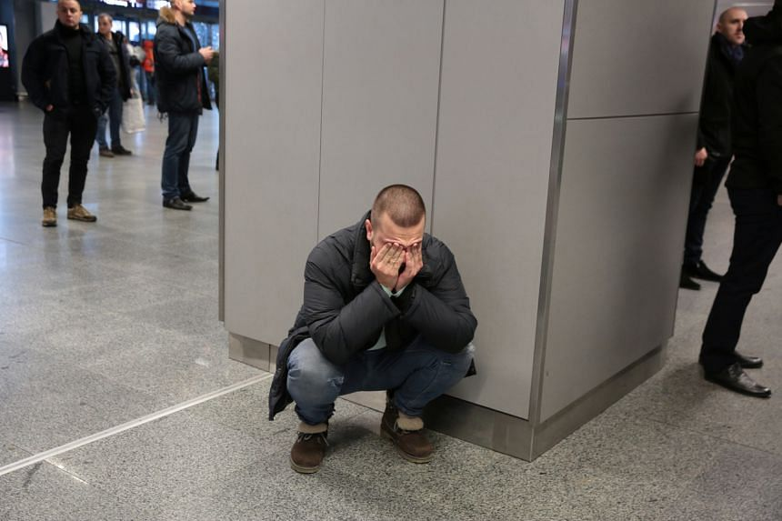 A relative of a victim of the Ukraine International Airlines PS 752 plane that crashed after taking off from Tehran's Imam Khomeini airport reacts at Boryspil International Airport, outside Kiev, Ukraine, on Ja 8, 2020.